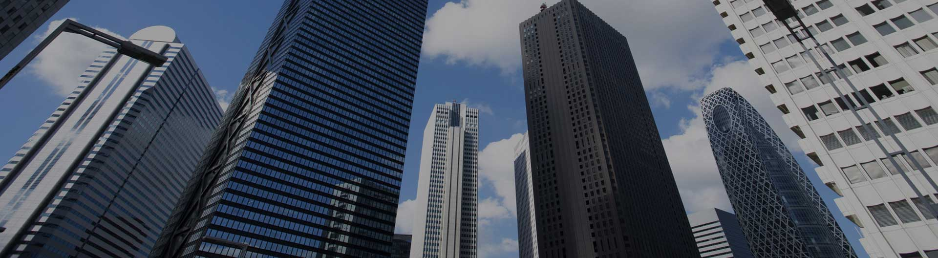 city picture looking upwards at skyscraper buildings