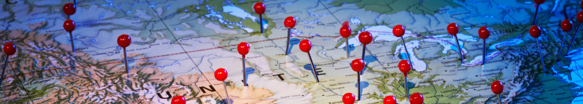 Close up of United States map with red push pins